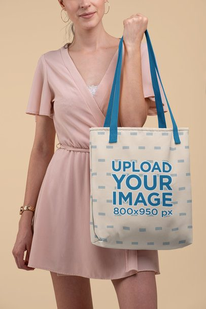 Mockup of a Woman Holding a Tote Bag with Customizable Strap at a Studio 28833