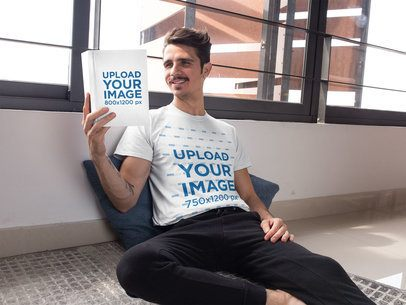 T-Shirt Mockup Featuring a Man Sitting on the Floor and Reading a Book 28496