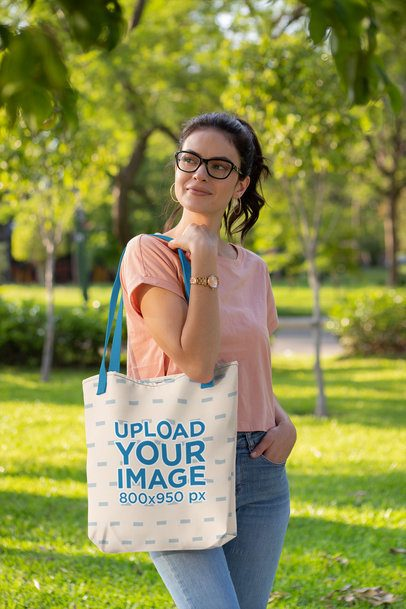Mockup of a Woman at a Park Carrying a Tote Bag with a Customizable Strap 28864