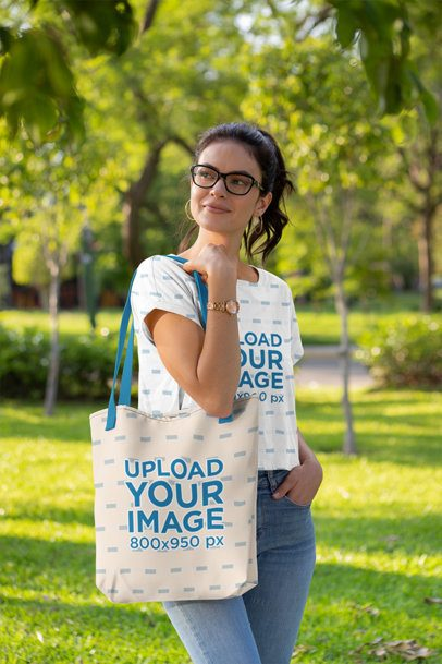 Crop Top Mockup of a Woman at a Park Carrying a Tote Bag with a Customizable Strap 28864