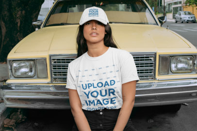 Crewneck T-Shirt Mockup of a Woman with a Dad Hat Posing in Front of an Old Car 28605