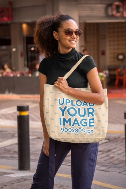 Tote Bag Mockup Featuring a Young Woman with Kinky Hair 28846