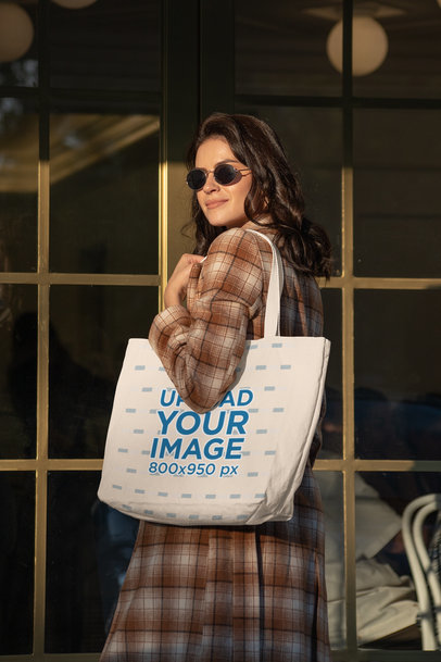Mockup of an Elegant and Classy Woman Carrying a Tote Bag