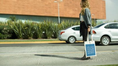 Tote Bag Video Featuring a Woman Standing in the Street 13982