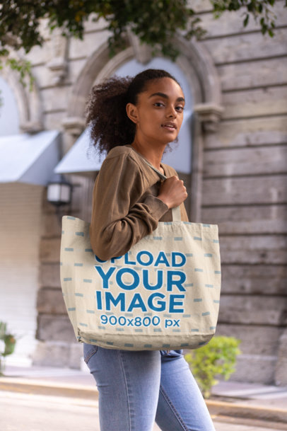 Mockup of a Curly-Haired Woman with a Tote Bag
