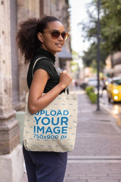 Tote Bag Mockup of a Trendy Woman with Sunglasses on a Sidewalk 28849