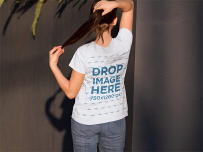 T-Shirt Mockup Featuring a Girl from the Back in a Courtyard a9173