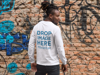 Back of a Guy with Dreadlocks Wearing a Long Sleeve Tee Mockup Against a Graffiti Covered Wall a9291