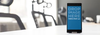 Mockup Template of a Sony Xperia in a Meeting Room Table a9489