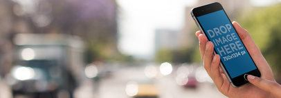 iPhone Mockup of a Man in an Urban Environment a9327
