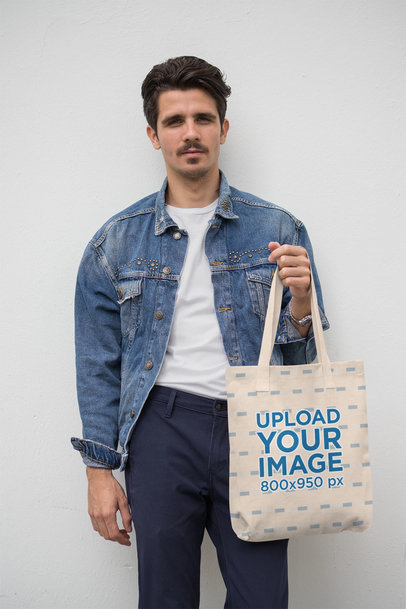 Mockup of a Trendy Man Holding a Tote Bag 28842
