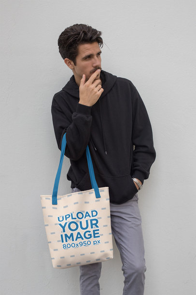 Mockup of a Tote Bag with a Customizable Strap Featuring a Young Man 28852
