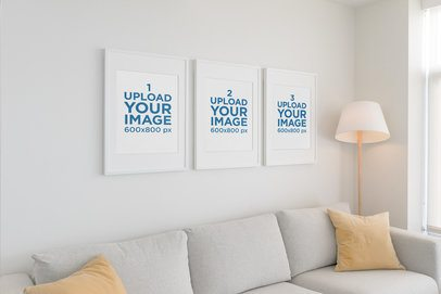 Mockup of Three Poster Frames Hanging on a White Living Room Wall 548-el