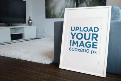 Mockup of a Poster Frame Leaning on a Living Room Sofa 607-el