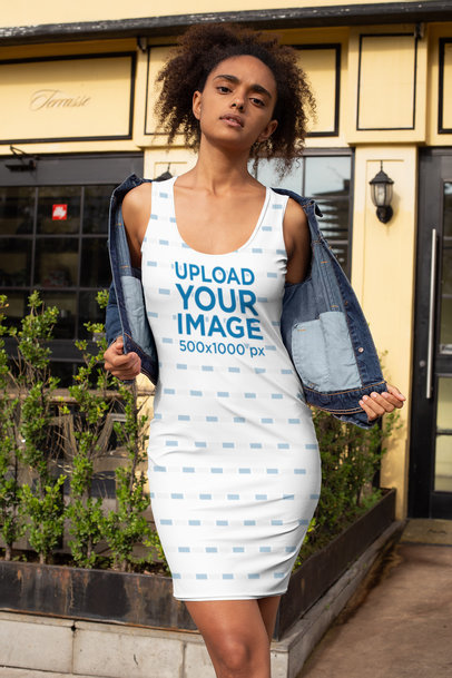Mockup of a Woman Wearing a Racerback Dress and Denim Jacket Outside a Restaurant 28781