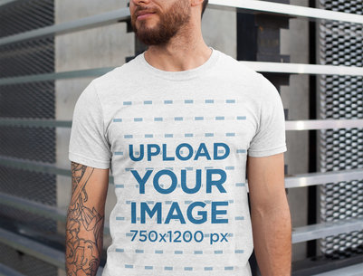 Heathered T-Shirt Mockup Featuring a Man with Tattoos on One Arm