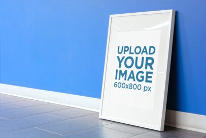 Poster Frame Mockup Leaning Against a Blue Wall 610-el