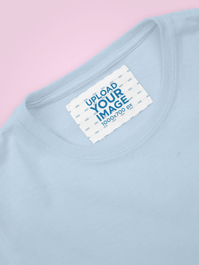 Clothing Label Mockup Featuring a Sweatshirt on a Flat Surface 28973