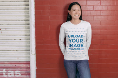 Long Sleeve Tee Mockup of a Woman Smiling with Her Hands Behind Her Back 29065
