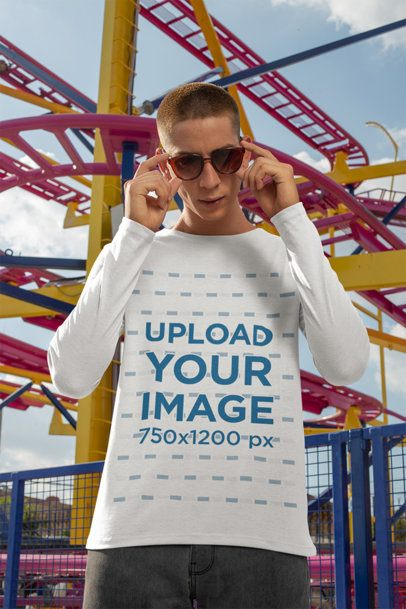 Long Sleeve Tee Mockup Featuring a Man with Sunglasses by a Roller Coaster 29046