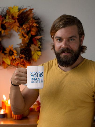 Mockup of a Bearded Man Holding a 15 oz Coffee Mug at His House 29138