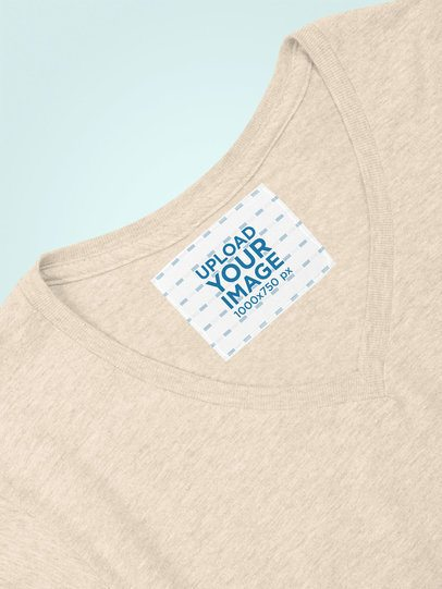 Inside Clothing Label Mockup Against a Flat Surface 28983