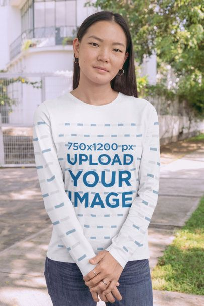 Long Sleeve Tee Mockup Featuring a Young Woman Standing on a Sidewalk 29069