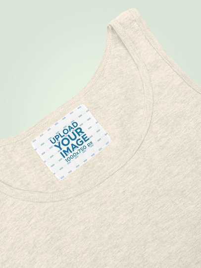Clothing Label Mockup Featuring a Heathered Tank Top Against a Plain Background 28981