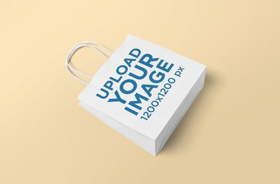 Mockup of a Gift Bag Lying on a Solid Color Surface 649-el