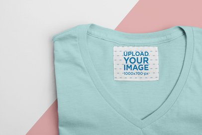 Mockup of an Inside Clothing Label on a Folded V-Neck Tee 28987