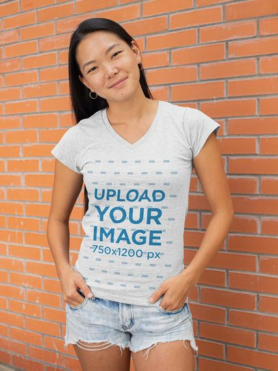 V-Neck Heather T-Shirt Mockup of a Young Woman Posing Against a Brick Wall 28749