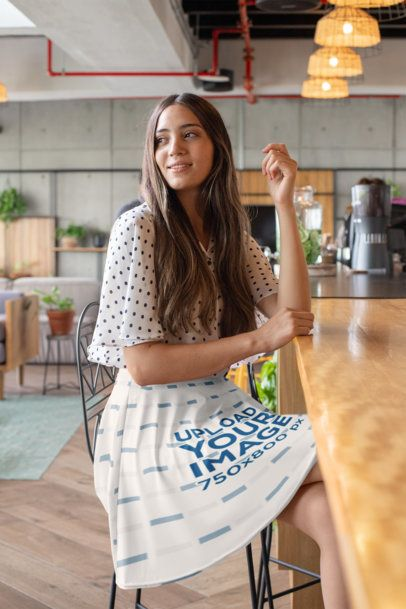 Skater Skirt Mockup Featuring a Long-Haired Woman Sitting at a Coffee Counter 28676