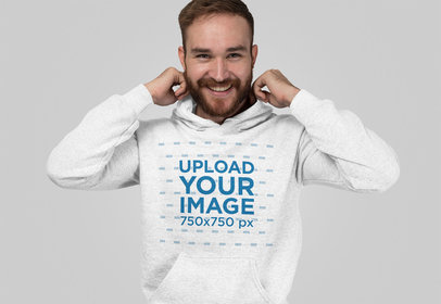 Heathered Hoodie Mockup of a Man Smiling at a Studio 28747