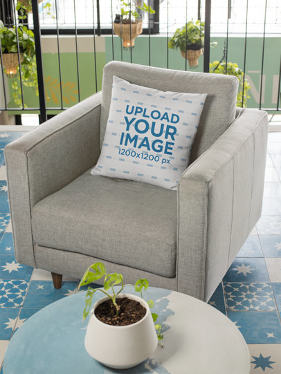 Mockup of a Square Pillow Placed on a Gray Minimalist Couch 29006