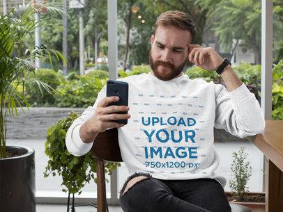 Crewneck Sweatshirt Mockup of a Man Checking His Phone 28735
