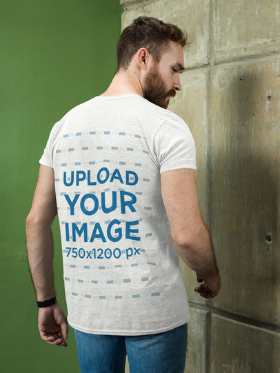 Heathered T-Shirt Mockup of a Bearded Man Facing the Wall 28739