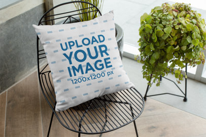 Mockup of a Pillow on a Chair 28998