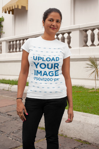 Mockup of a Woman Wearing a T-Shirt Outside a Restaurant 28933