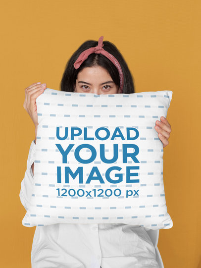 Mockup of a Woman Covering Her Face with a Pillow at a Studio 29020