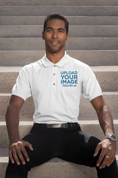Embroidered Polo Shirt Mockup of a Business Man Sitting on Concrete Stairs 28908