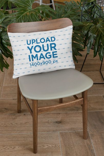 Throw Pillow Mockup Placed over a Chair 28999