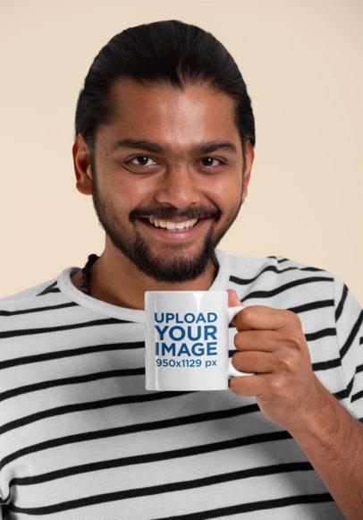 11 oz Coffee Mug Mockup Featuring a Smiling Man with a Beard at a Studio 29095