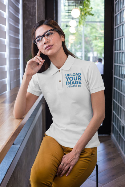 Polo Shirt Mockup of a Woman with Glasses Sitting at a Cafeteria 28890