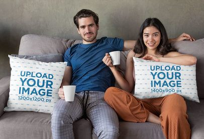 Mockup of a Couple Having Coffee on the Couch with Pillows 29012