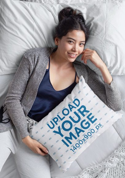 Mockup of a Woman Holding a Pillow in Bed 29022
