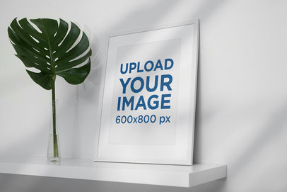 Poster Frame Mockup Placed by a Palm Leaf in a Minimalistic Scenario 497-el