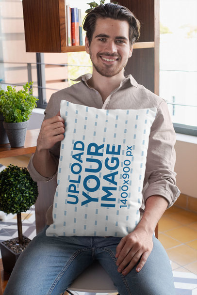Pillow Mockup of a Man Sitting on a Chair at Home 29019