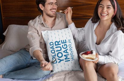 Throw Pillow Mockup Featuring a Couple Eating on a Bed 29017
