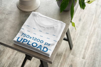 T-Shirt Mockup Featuring a Folded Tee on the Corner of a Table 377-el