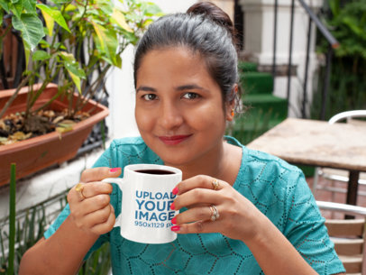 11 oz Mug Mockup Featuring a Woman with a Hair Bun Drinking Coffee 28940